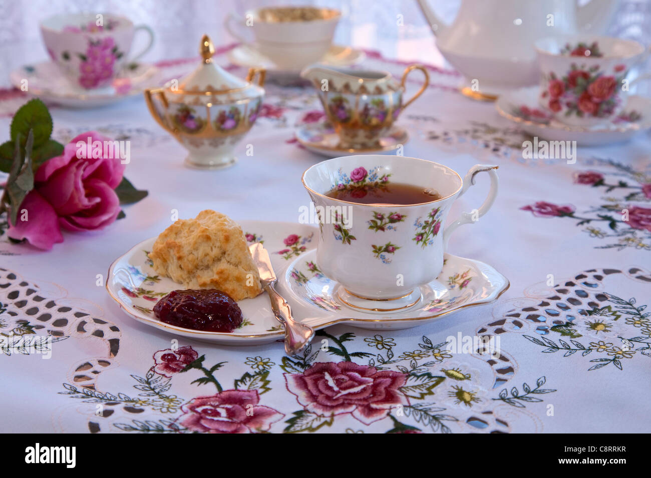 English High Tea with scones and Jam at a table setting Stock