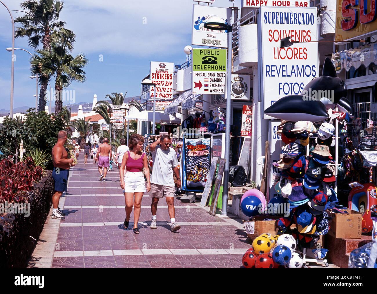 Holidaymakers Walking Along The Promenade Playa De Las