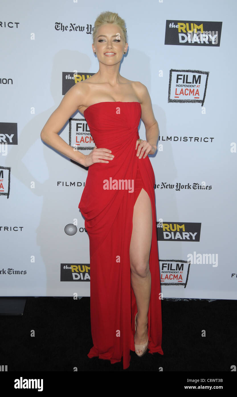 Amber Heard (wearing an Elie Saab gown) at arrivals for ...