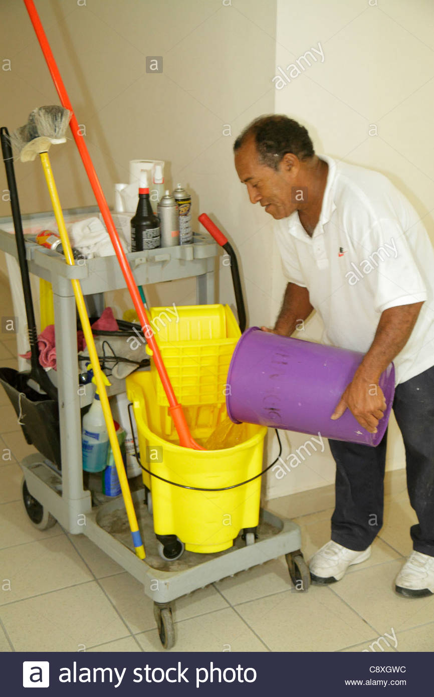 miami beach florida presidential condominiums custodian job miami beach florida presidential condominiums custodian job hispanic man janitor mop bucket pouring water