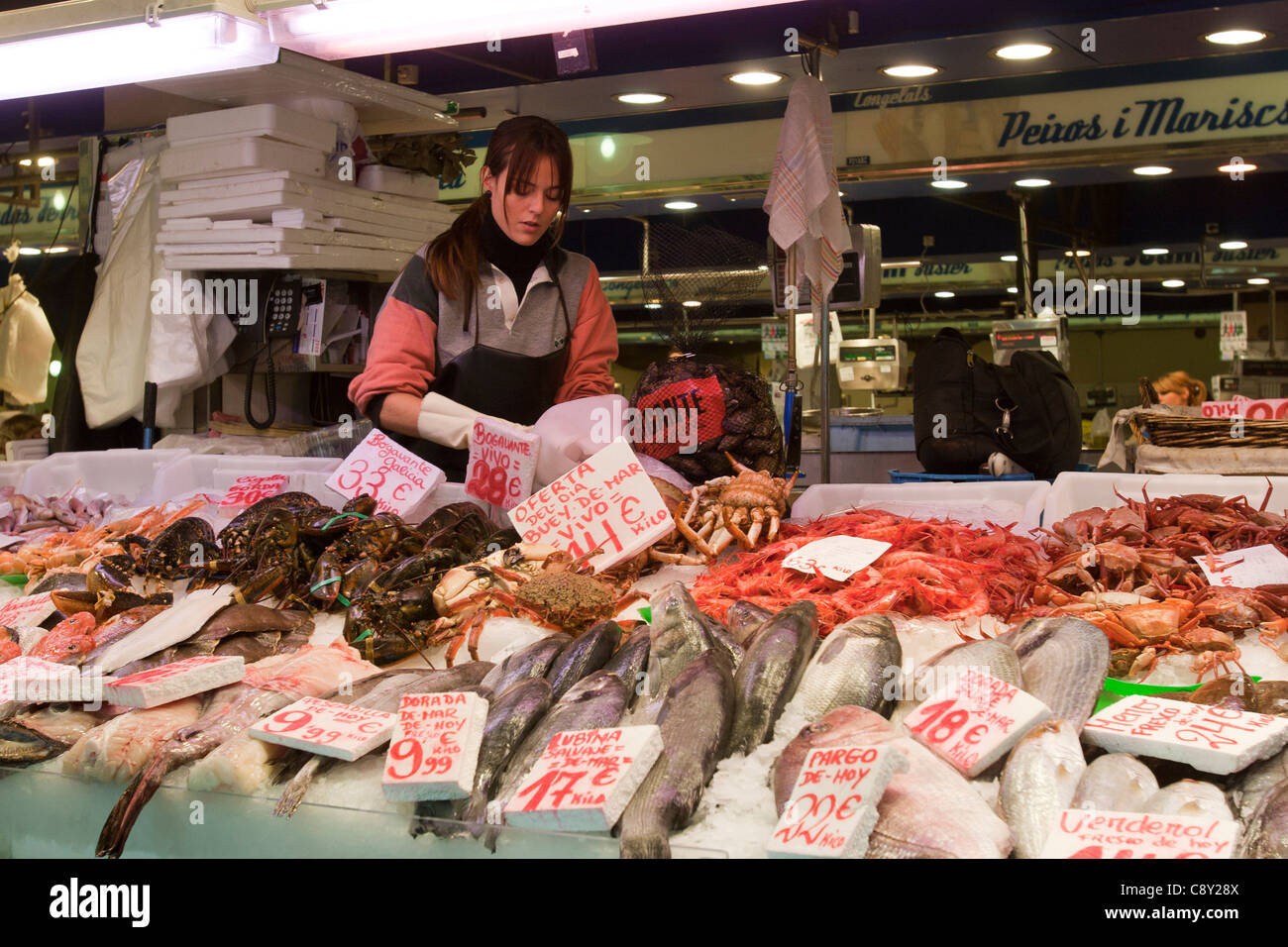 woman seller in fish counter market mercat santa catalina