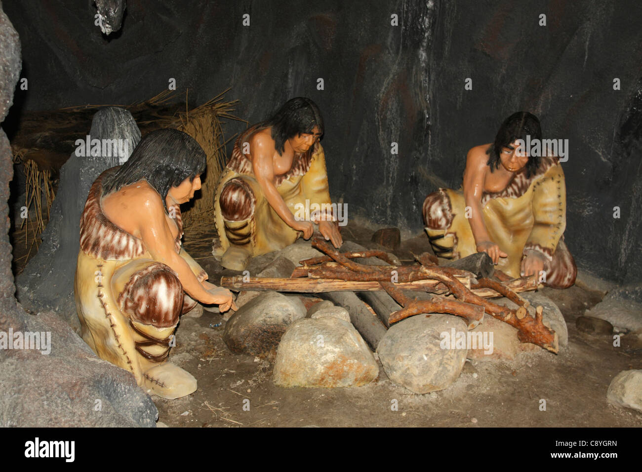 Neanderthal people sitting at the fire in a cave, Leba ...  Neanderthal peo...