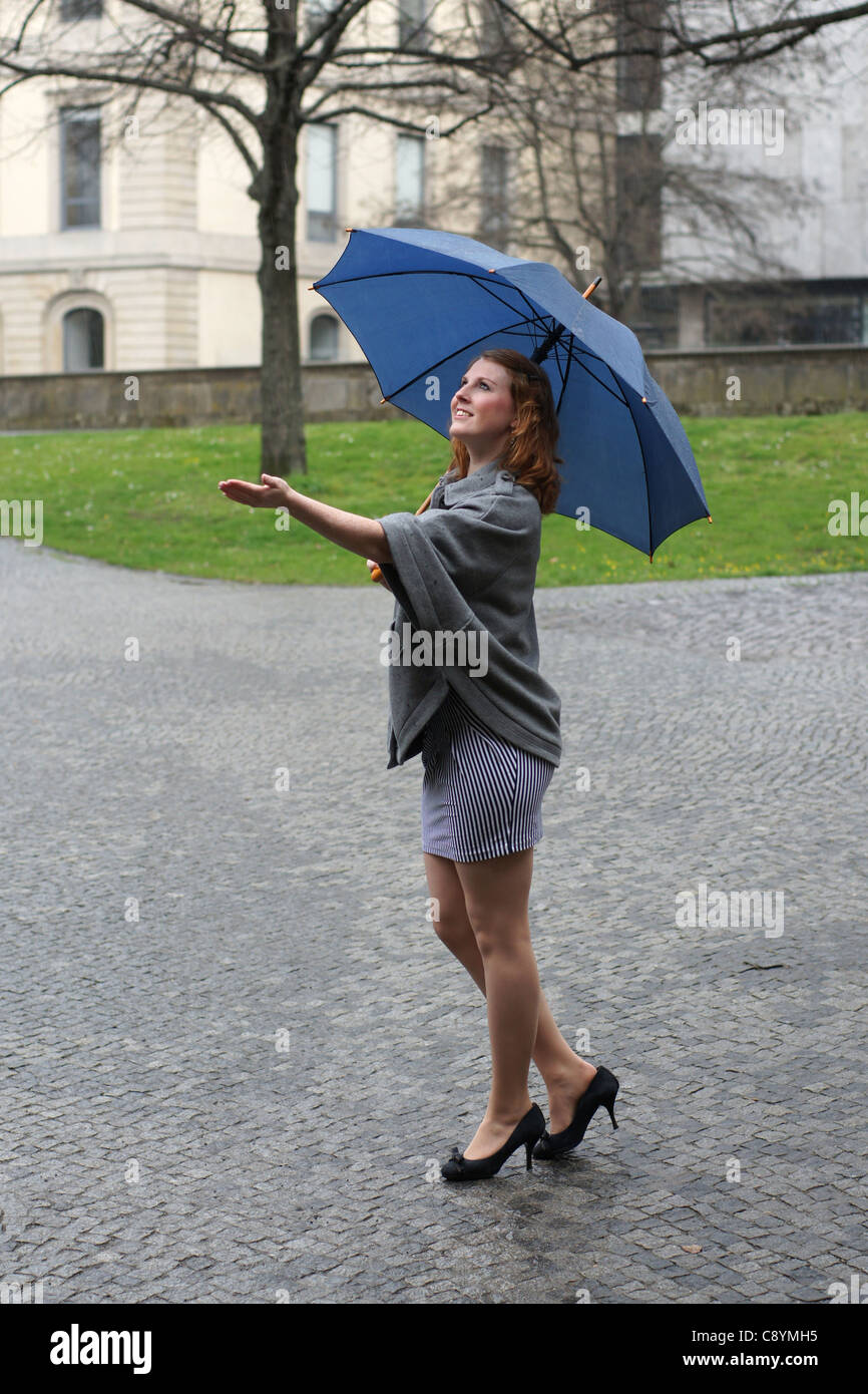 Young Woman With Umbrella Enjoying The Rain Stock Photo ...