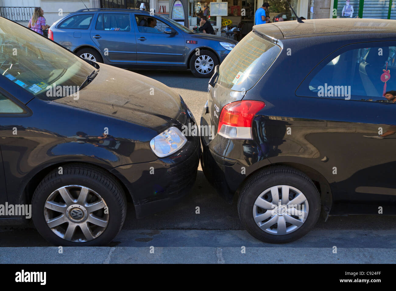 Parking in Paris. Cars are often parked so close they touch each ...