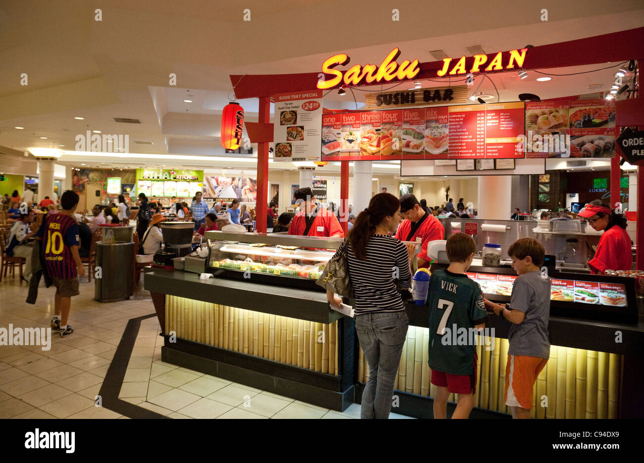 People at a sushi bar montgomery shopping mall for American cuisine washington dc