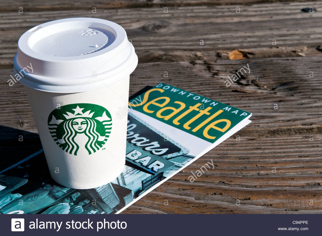 Starbucks Cup Of Coffee On A Seattle Downtown Map Seattle Stock - Usa map seattle