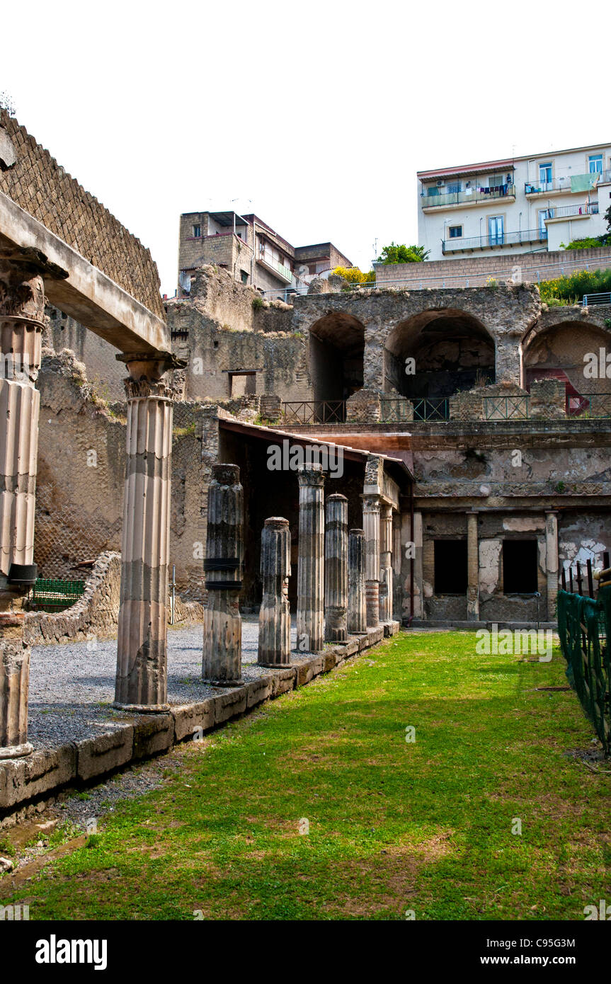The modern houses of ercolano look down onto the fluted corinthian columns supporting the portico of