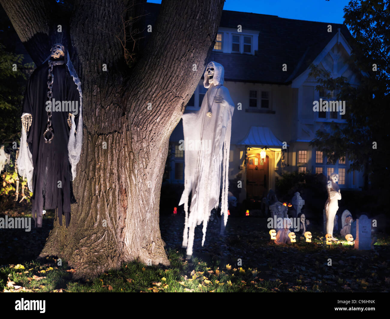 spooky halloween decoration ghosts and cemetery in the front yard of a house in toronto canada - Cemetery Halloween Decorations