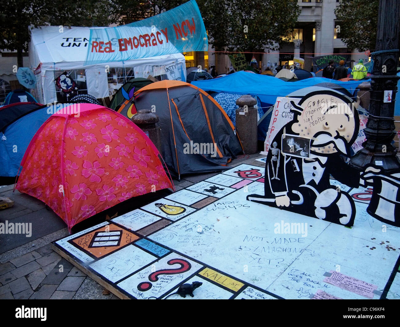 joke monopoly board mocking capitalist monetary values in anti-capitalist demonstration at St Paulu0027s Cathedral London 2011 u0026 dome tents of protesters  sc 1 st  Alamy & joke monopoly board mocking capitalist monetary values in Stock ...