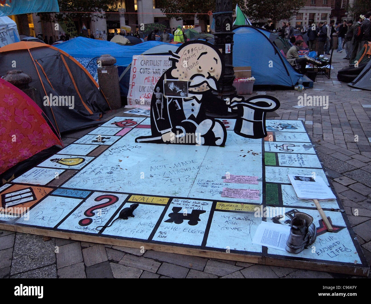 joke monopoly board mocking capitalist monetary values in anti-capitalist demonstration at St Paulu0027s Cathedral London 2011 u0026 dome tents of protesters & joke monopoly board mocking capitalist monetary values in Stock ...
