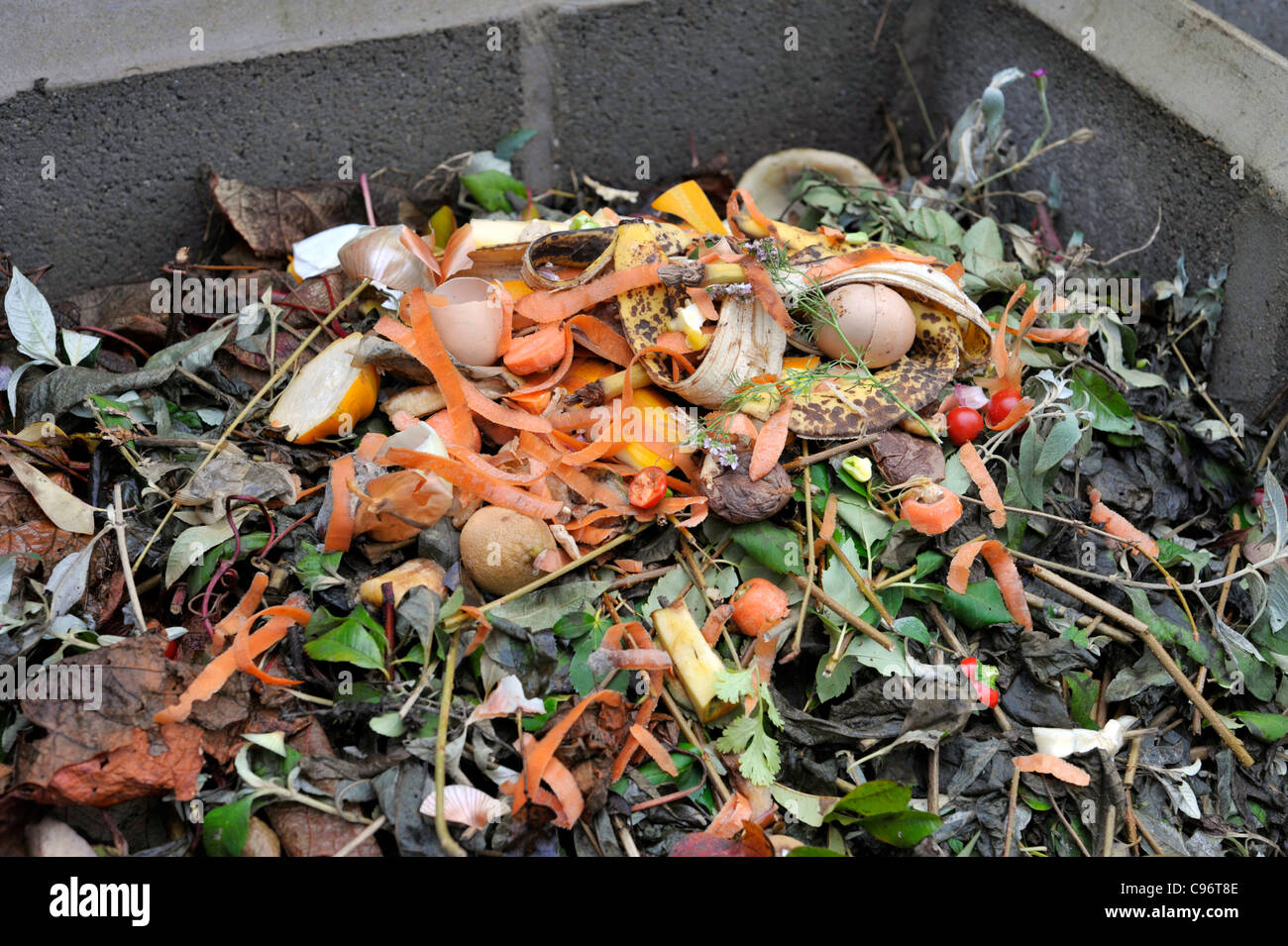 Garden compost heap with plant material and kitchen waste for Waste material images