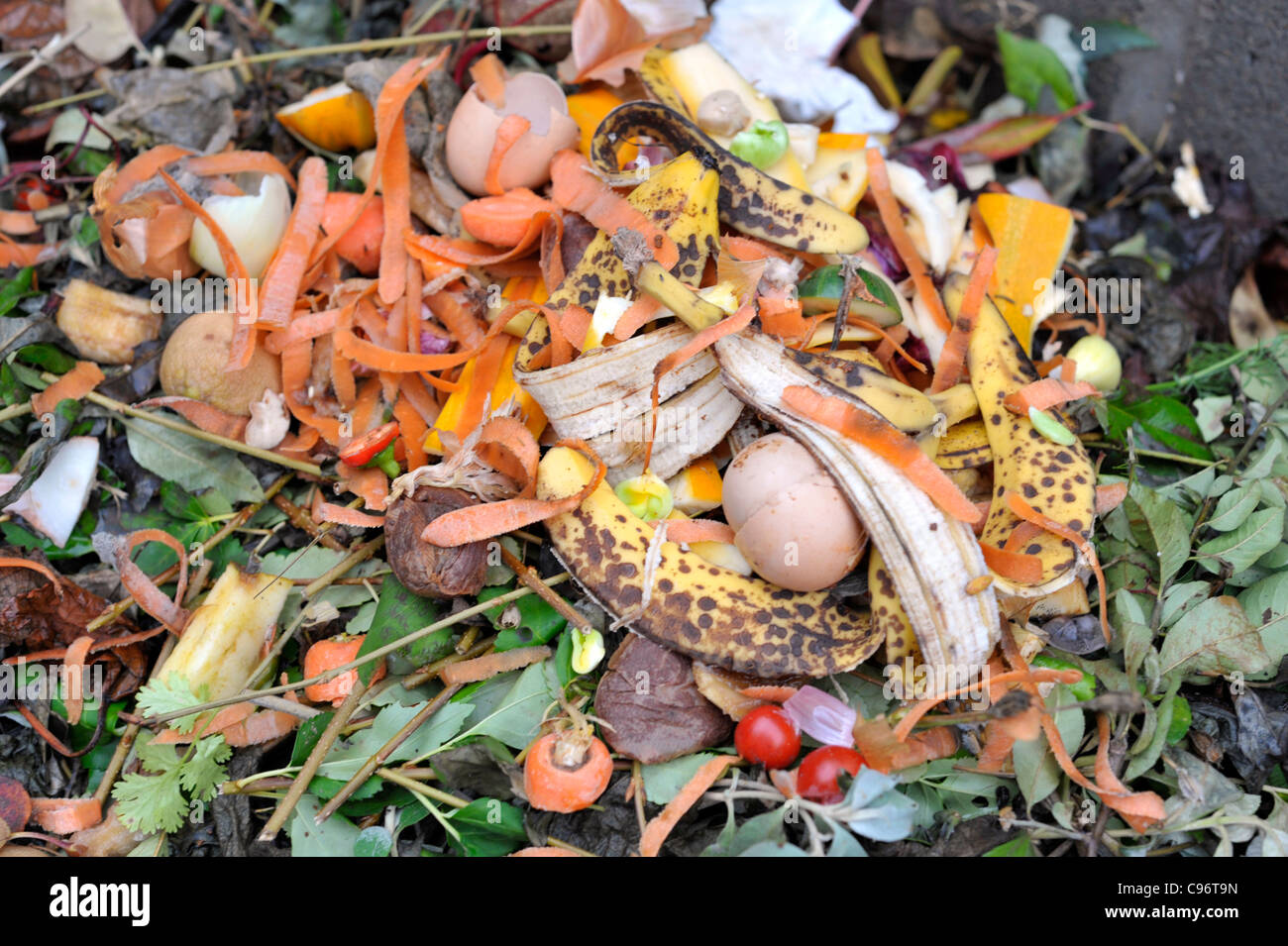 Garden Compost Heap With Plant Material And Kitchen Waste Stock