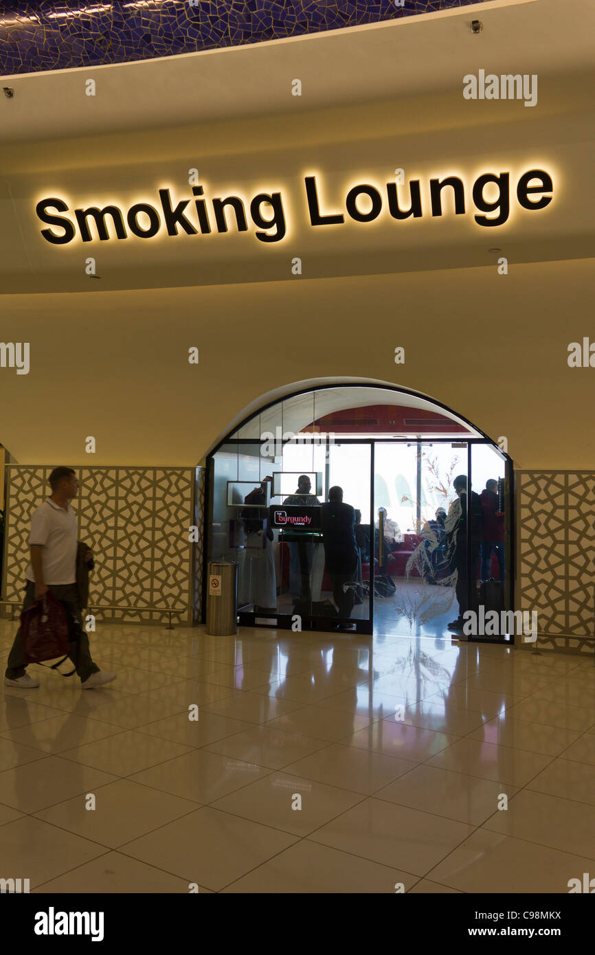 smoking lounge international terminal 1 abu dhabi airport united arab emirates stock