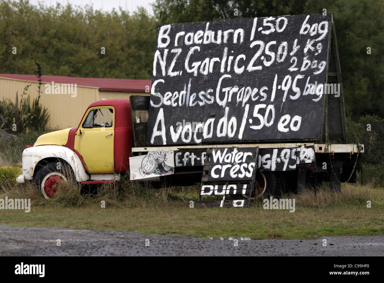 Old truck with large advertising blackboard sign promoting fresh ...