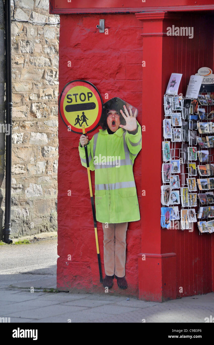 http://c8.alamy.com/comp/C9B3F6/a-life-size-picture-of-a-lollipop-lady-stuck-on-a-shop-wall-on-a-high-C9B3F6.jpg