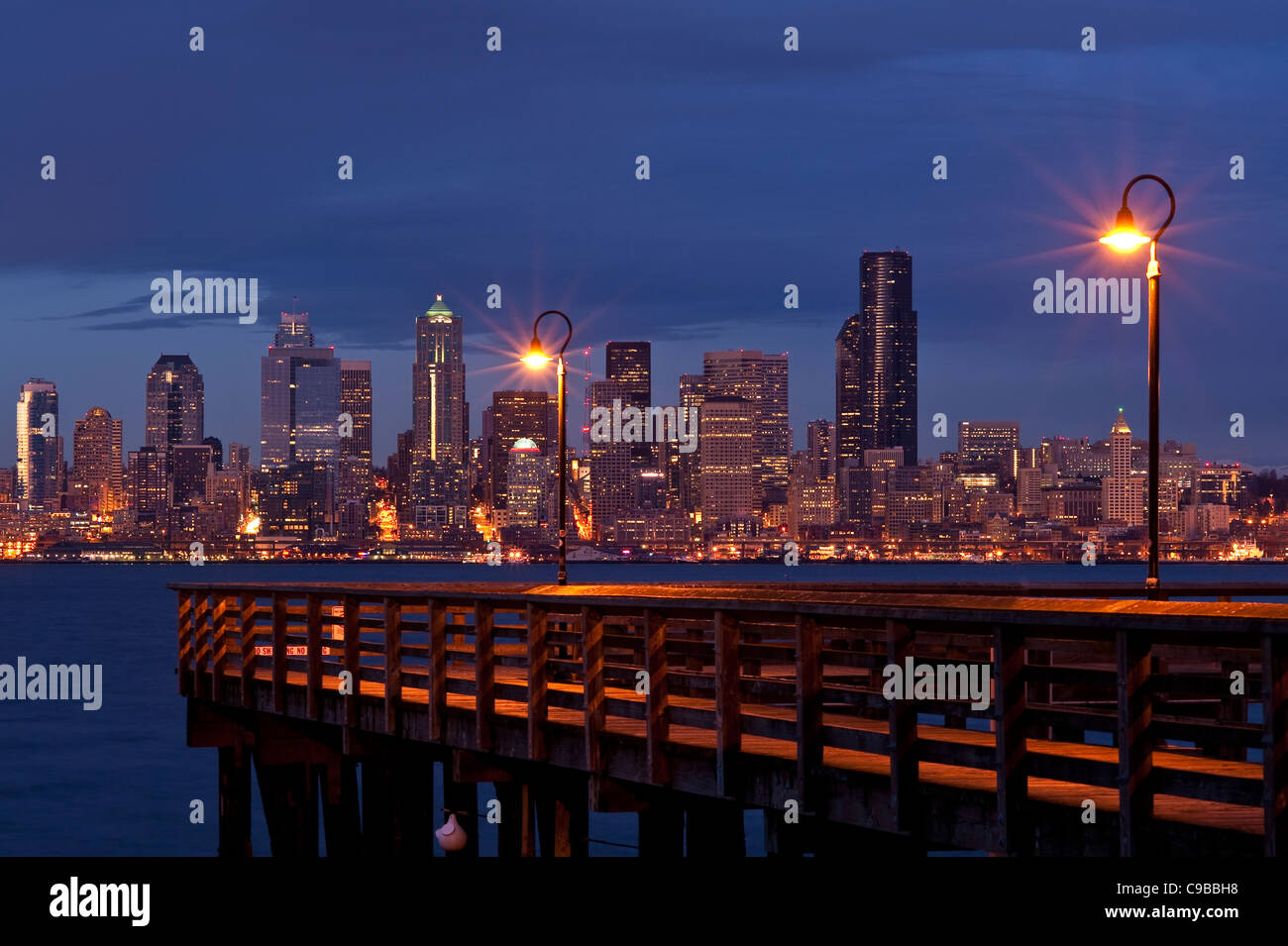 Sunset seattle skyline with fishing pier on elliott bay for Fishing in seattle washington