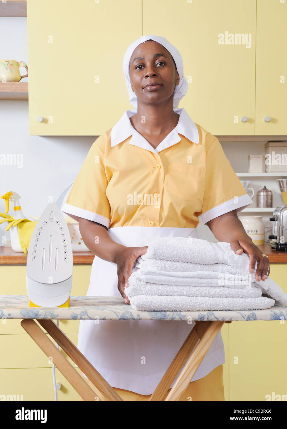 White apron cape town - Domestic Worker With Ironing Board Iron And White Sheets Cape Town Western Cape Province South Africa