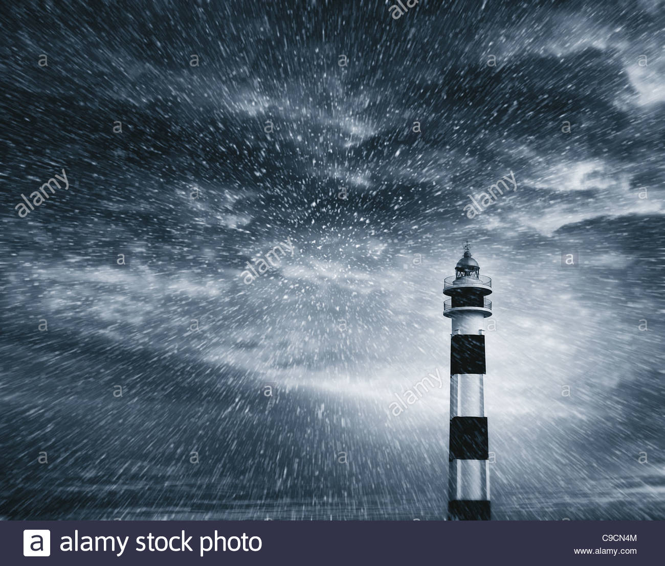 lighthouse snow storm Stock Photo, Royalty Free Image ...