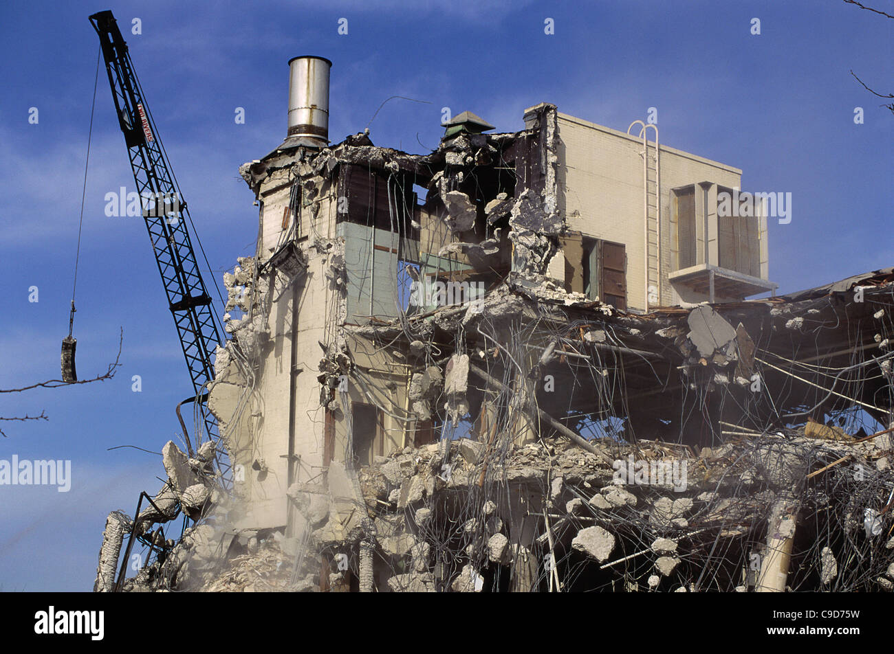wrecking ball and a demolished building stock photo
