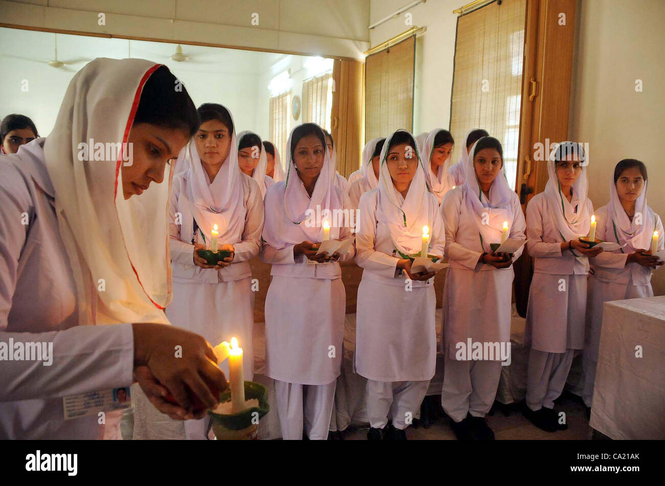 Nurses hold lightened candles on the occasion of seventh lamp ... for Lamp Lighting Ceremony  110zmd