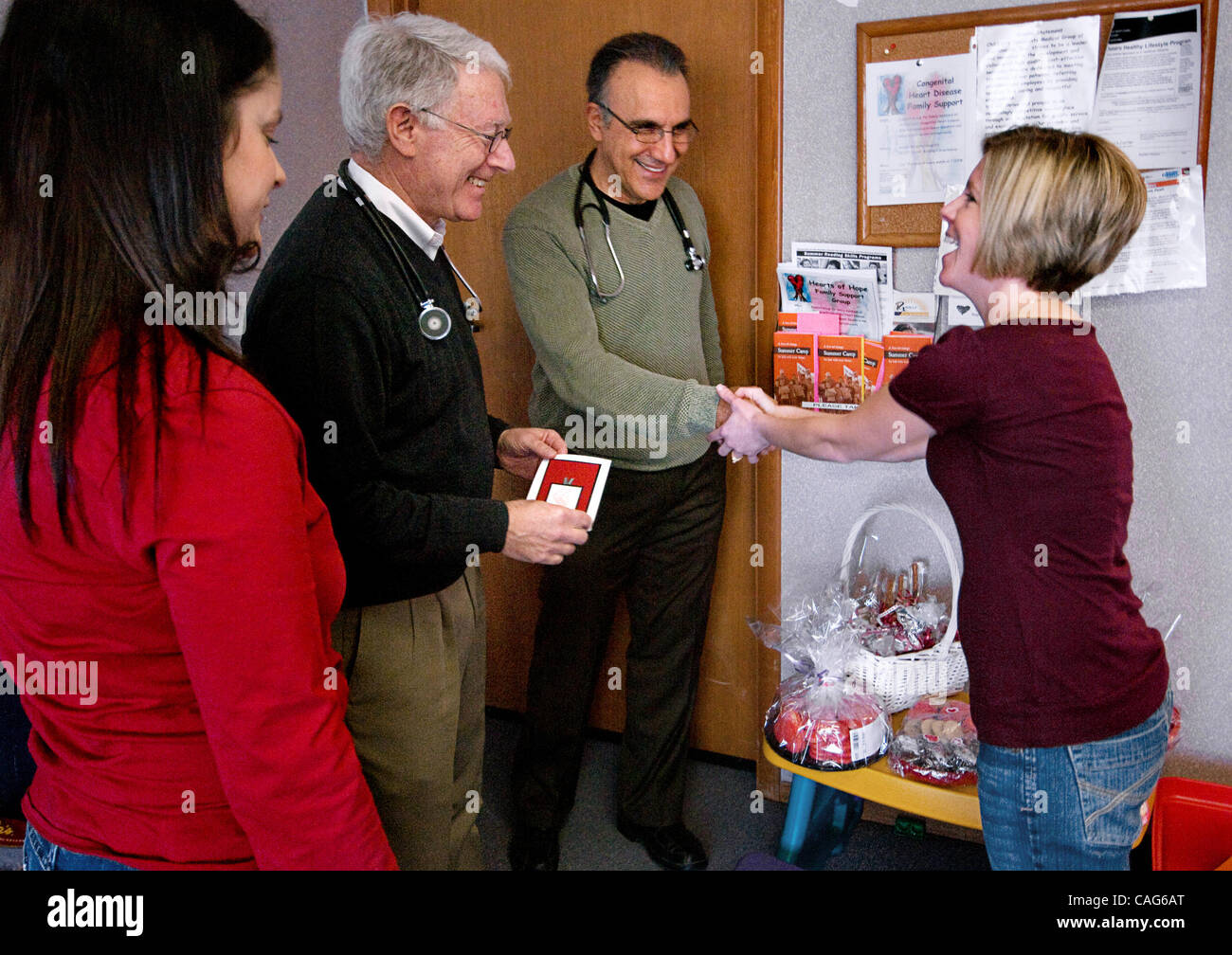JUMP Valerie Boesen (cq), Left, Delivers Valentine Cookie Baskets To  Pediatric Cardiologists Dr. Andrew Juris (cq) And Dr. Hessam Fallah (cq)  With Amber ...