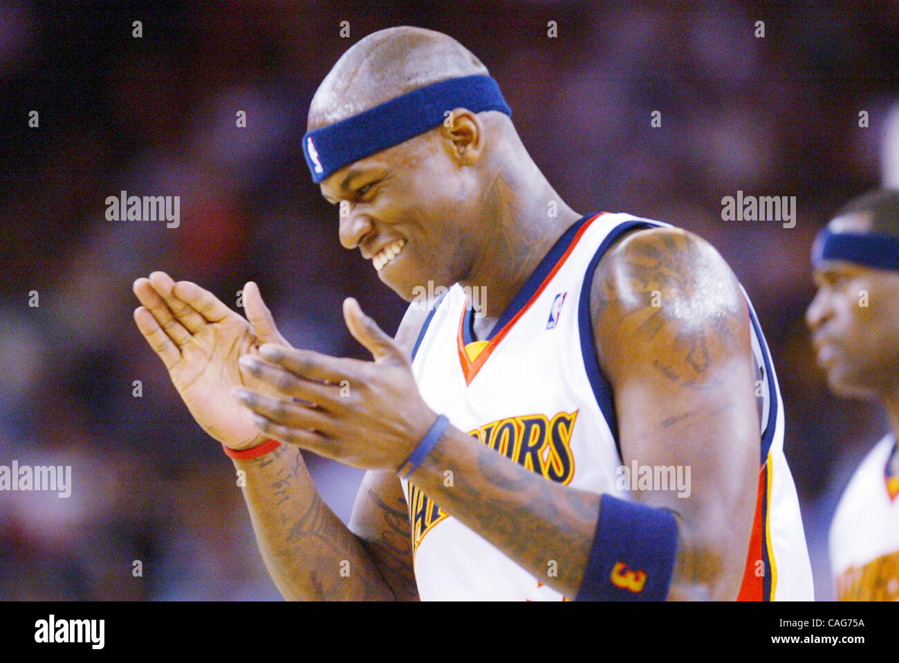 Golden State Warriors Al Harrington applauds at the end of the