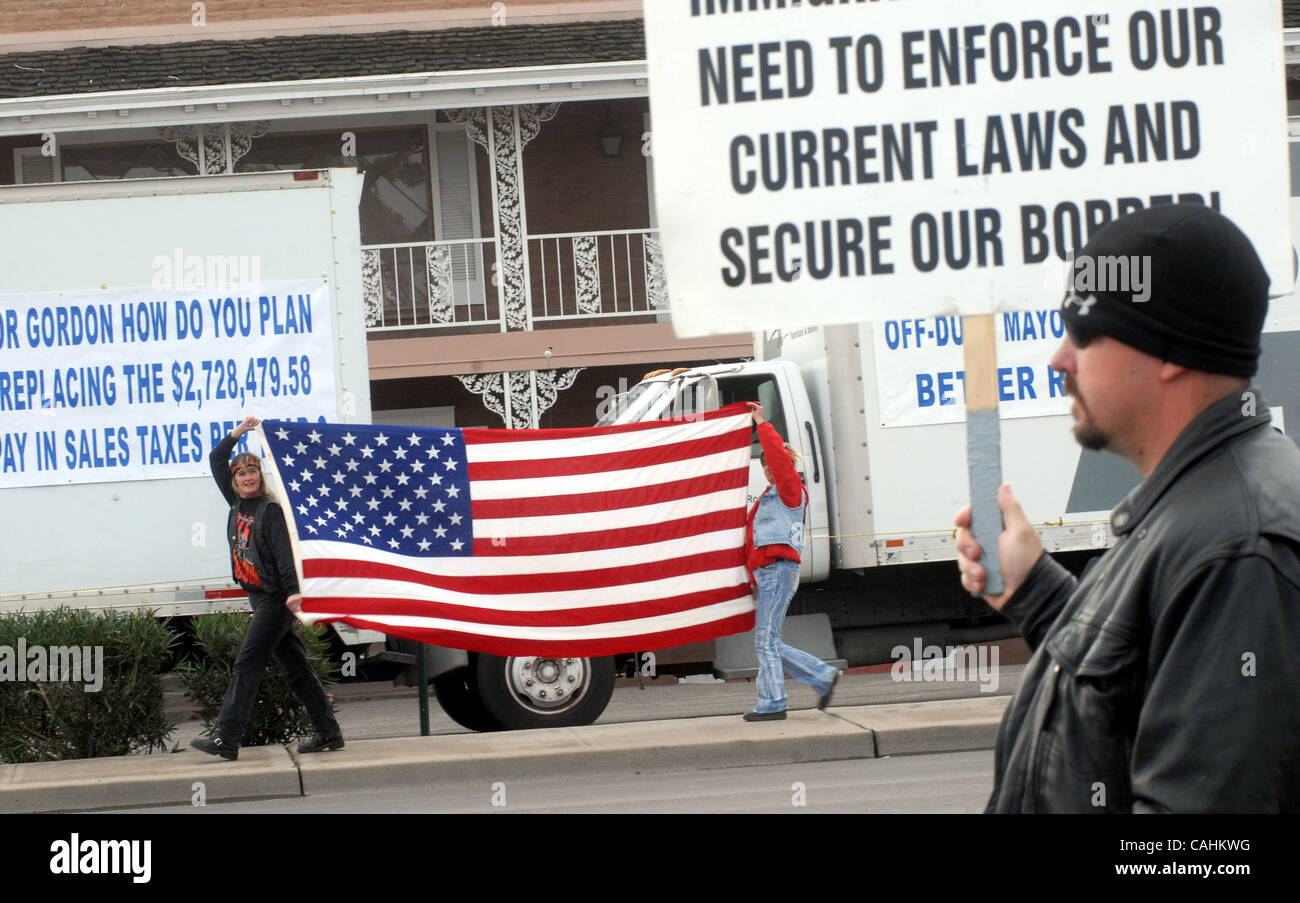 ... Immigration Protesters PATTI WITHERSPOON (left) And CINDI KLECK Both  From Phoenix, Arizona Carry An American Flag In Front Of Pruitts Furniture  Store.