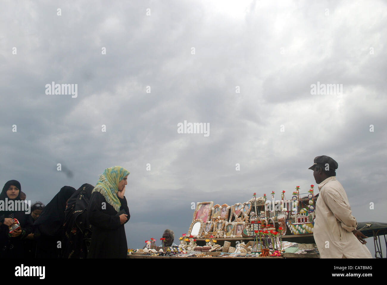 Women buy handmade home decoration items at stall while ...