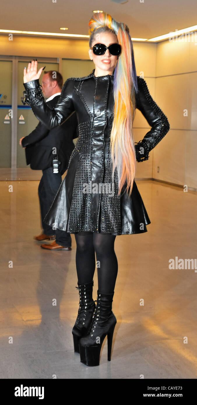 lady gaga wearing a black leather coat sunglasses high
