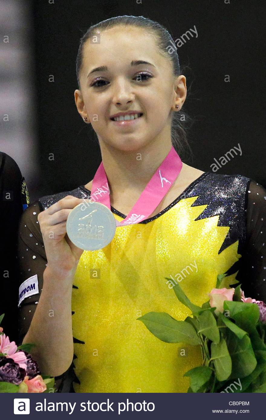Stock Photo - epa03217499 Gold medalist Romanian Larisa Andreea Iordache stands on the podium after winning the seniors floor apparatus finals at the Women ... - epa03217499-gold-medalist-romanian-larisa-andreea-iordache-stands-CB0PBM