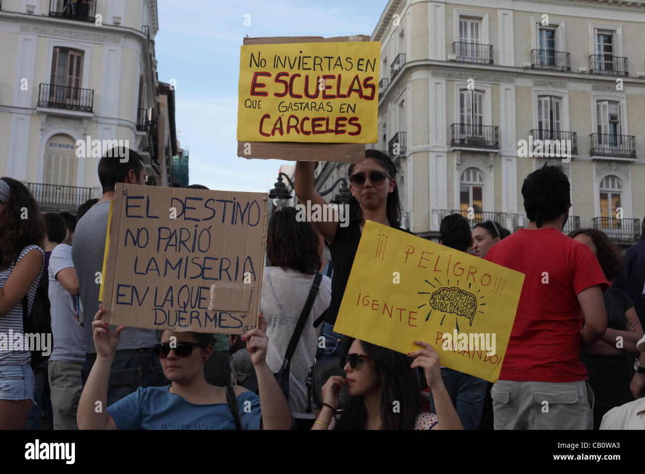 Madrid spain protesters hold signs during the one year