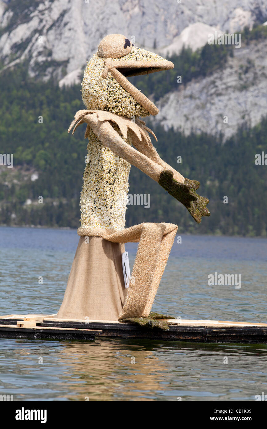 the boat parade the narcissus figures on the lake of stock photo the boat parade the narcissus figures on the lake of altaussee at the 53rd narcissus festival in ausseerland salzkammergut styria