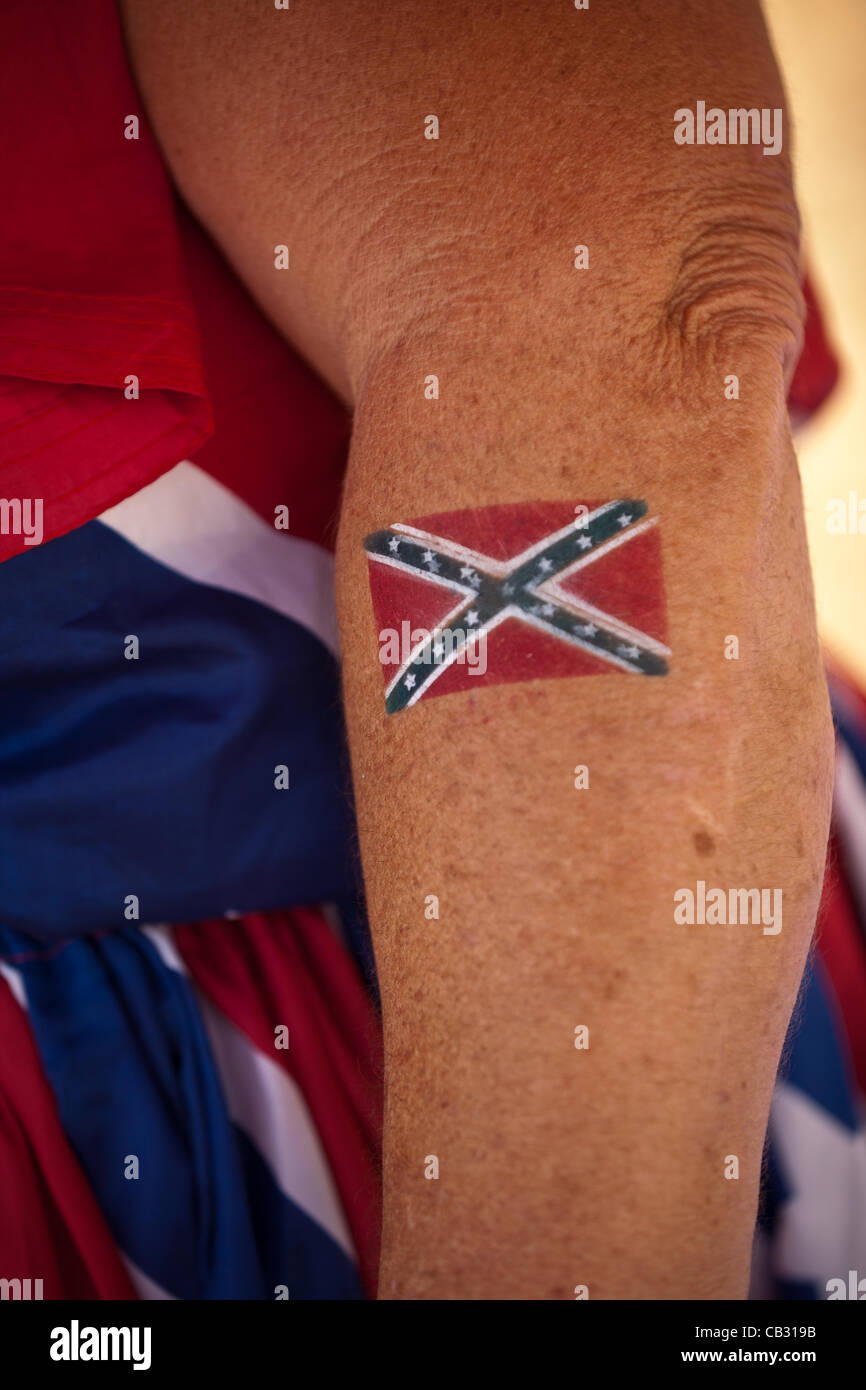 A woman shows off her confederate flag tattoo at the for Oklahoma flag tattoo