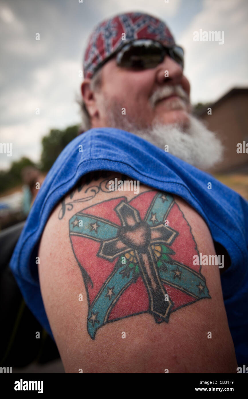 A man shows off his confederate flag tattoo at the summer for Oklahoma flag tattoo