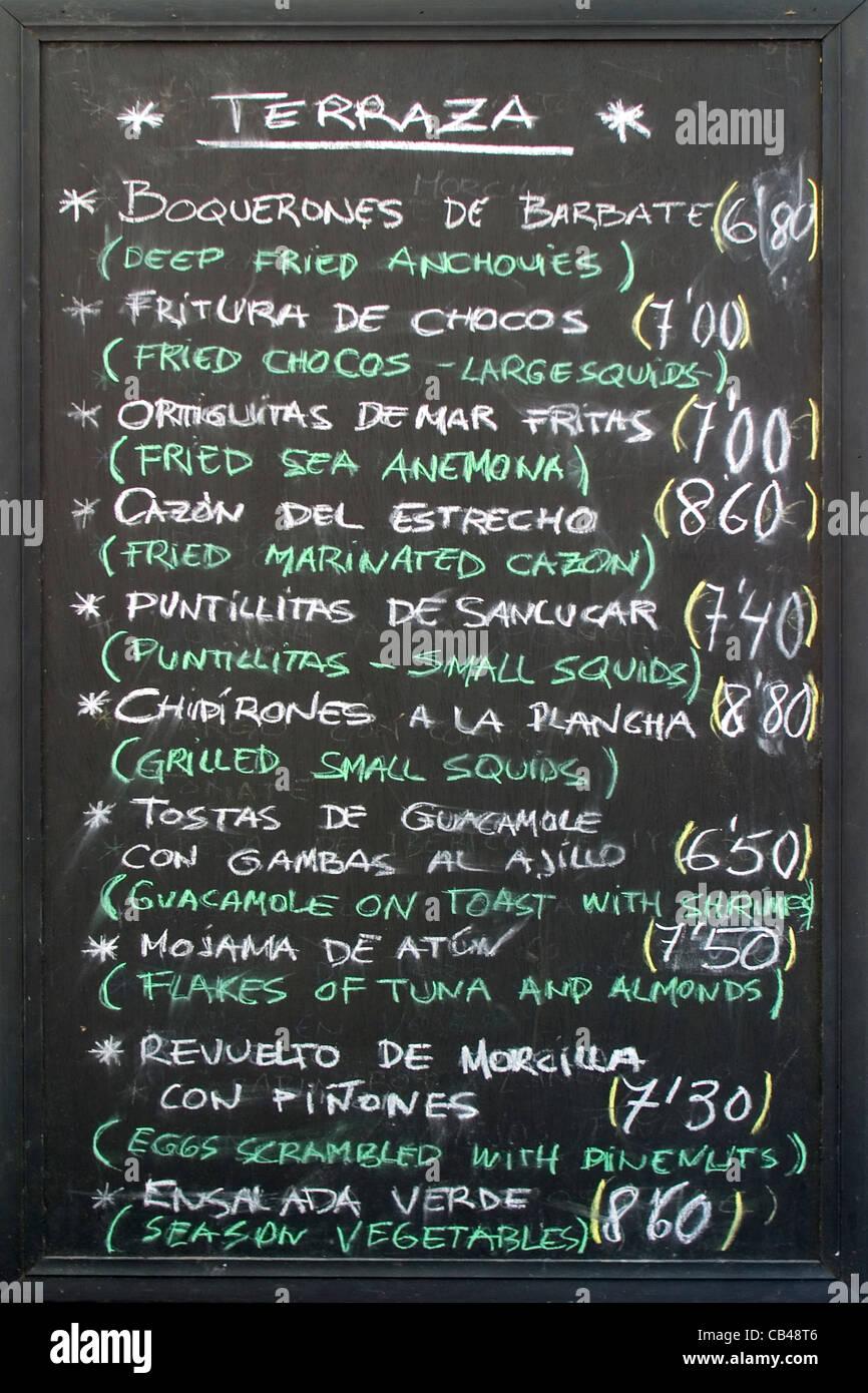 ... Spanish Restaurant Menu Written On Blackboard In Vejer, Andalucia,  Spain   Stock Photo