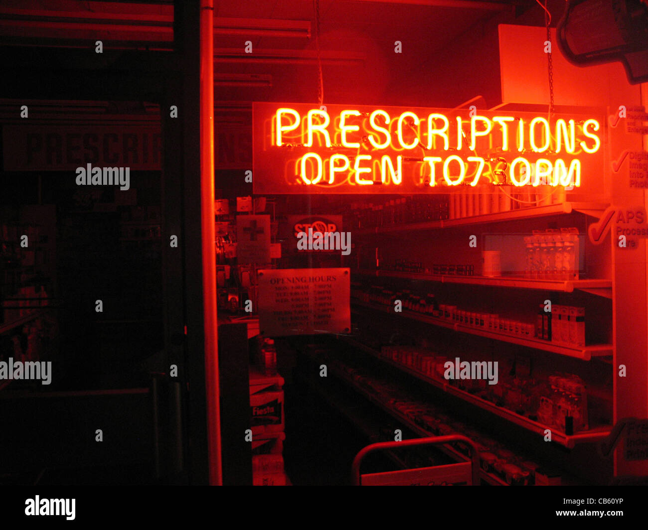 Open window at night - Chemist Shop Window At Night With A Glowing Red Neon Sign Saying Prescriptions And Giving The Store Opening Times
