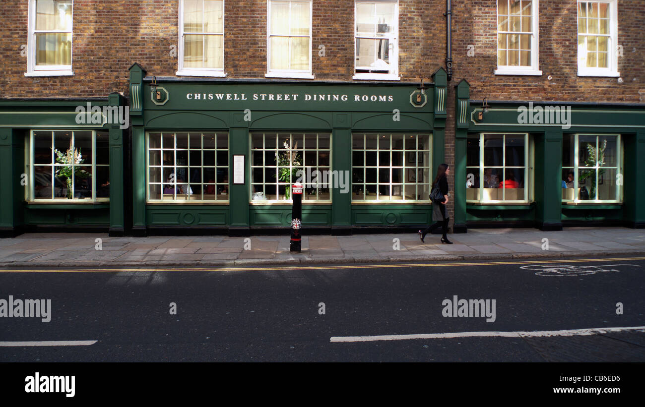 a woman walking past chiswell street dining rooms restaurant