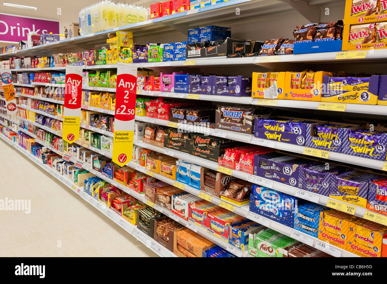 Chocolates And Sweets On Shelves In A Tesco Store Stock