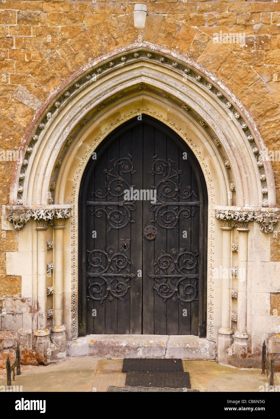 Ornate Pointed Gothic Arch Church Door With Fleuron Decorated Hinges St James Little Dalby Leicestershire England UK