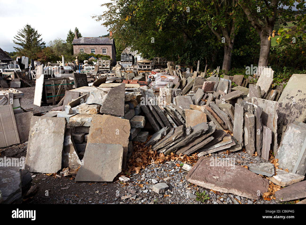 Stone slabs and flagstones in architectural salvage yard wales uk stock photo royalty free for Home architectural salvage yards