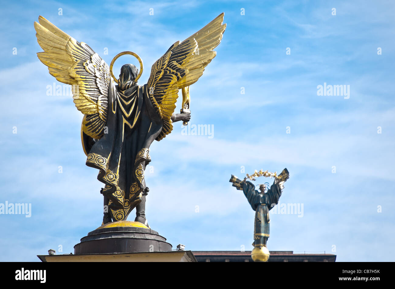 Statue of archangel michael and ukraine national symbol statue on statue of archangel michael and ukraine national symbol statue on independence square in kiev biocorpaavc Images