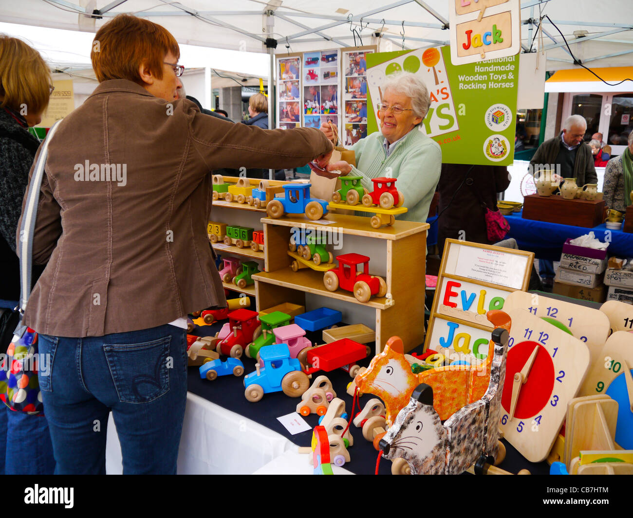 Female customer buying wooden toys at Made in Shropshire ...