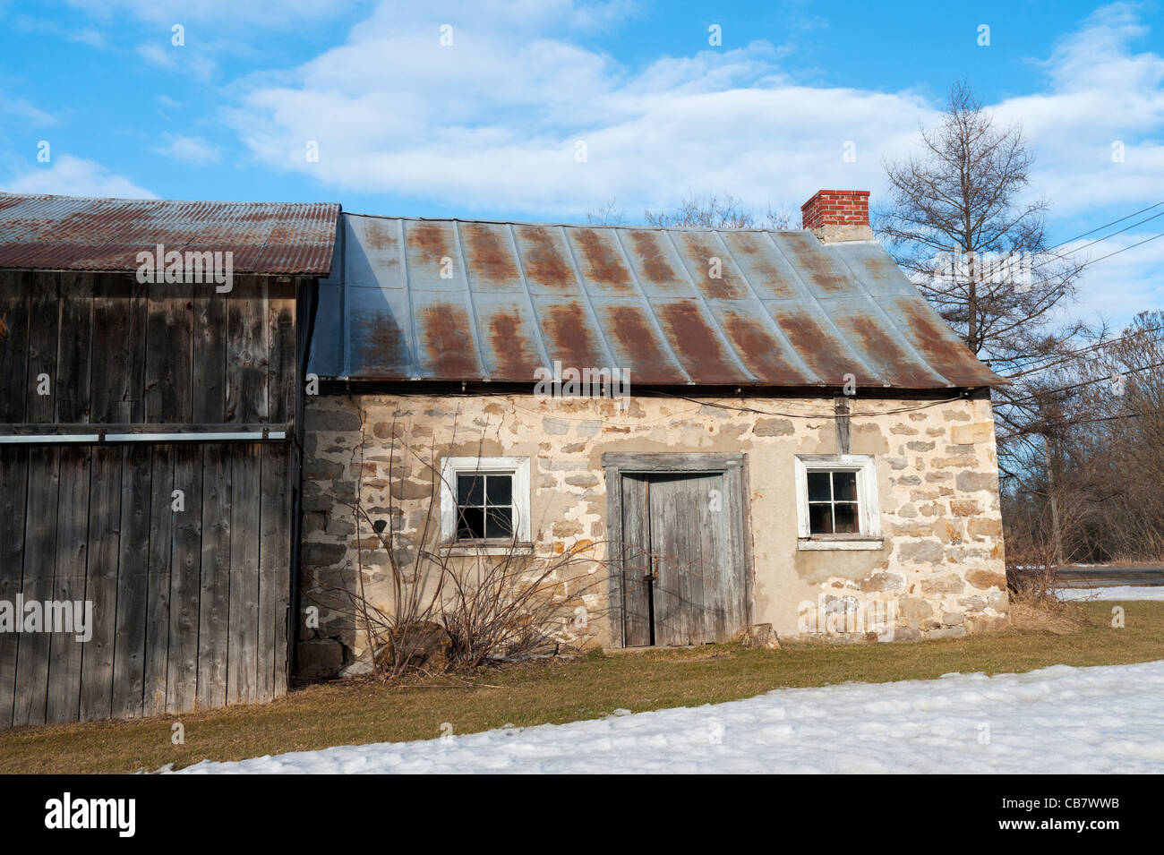Old Stone House With Corrugated Tin Roof Near St Eustache, Province Of  Quebec, Canada.