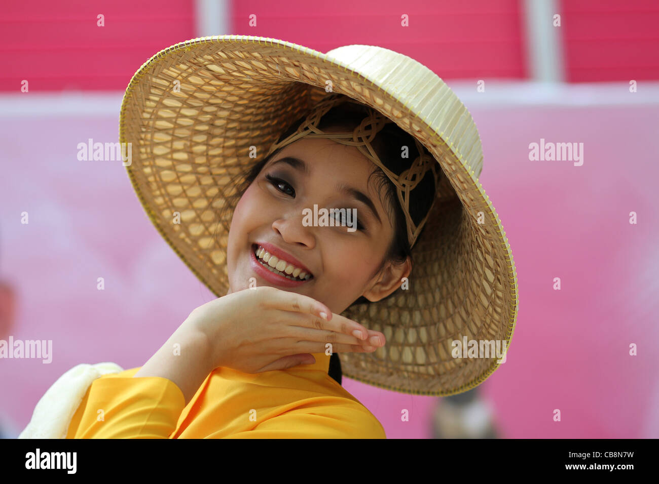 Thai girl smile stock photos thai girl smile stock images alamy a thai girl in traditional costume and wearing a basket weave hat gestures with her kristyandbryce Images