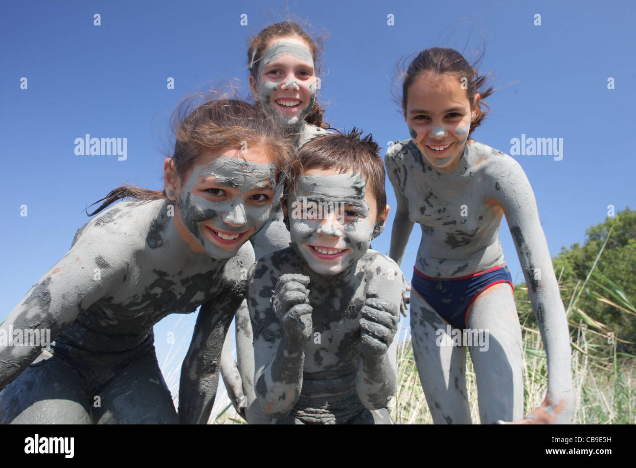 Kids Covered With A Healing Mud Play On The Beach Tuzlata Resort Near Town Of Balchik Black Sea Coast Bulgaria
