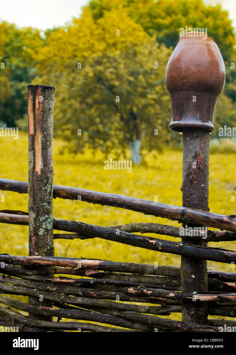 Wooden Farm Fence pot on wooden farm fence with grass and tree in background stock