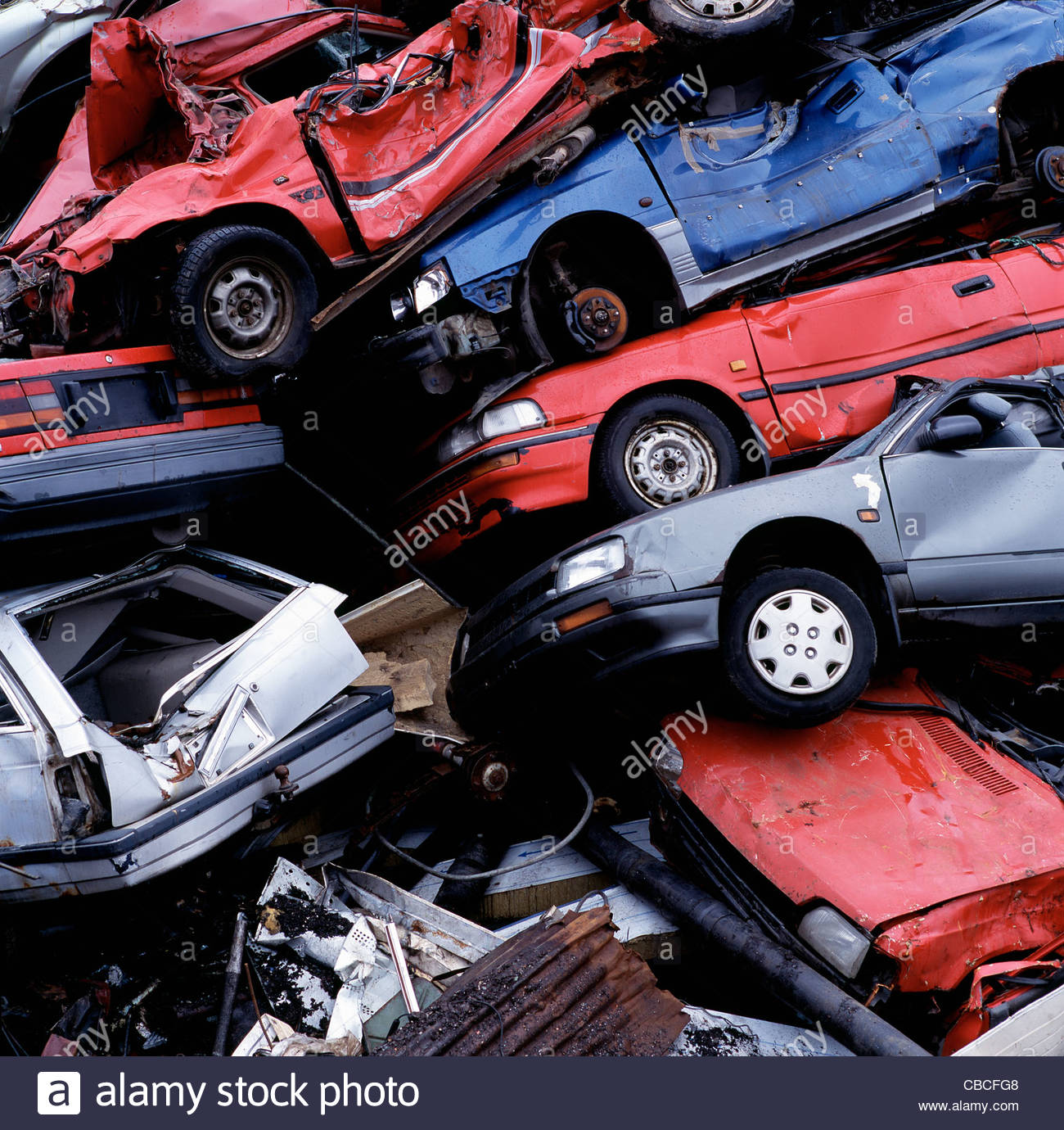 Wrecked cars in pile at junkyard Stock Photo, Royalty Free Image ...