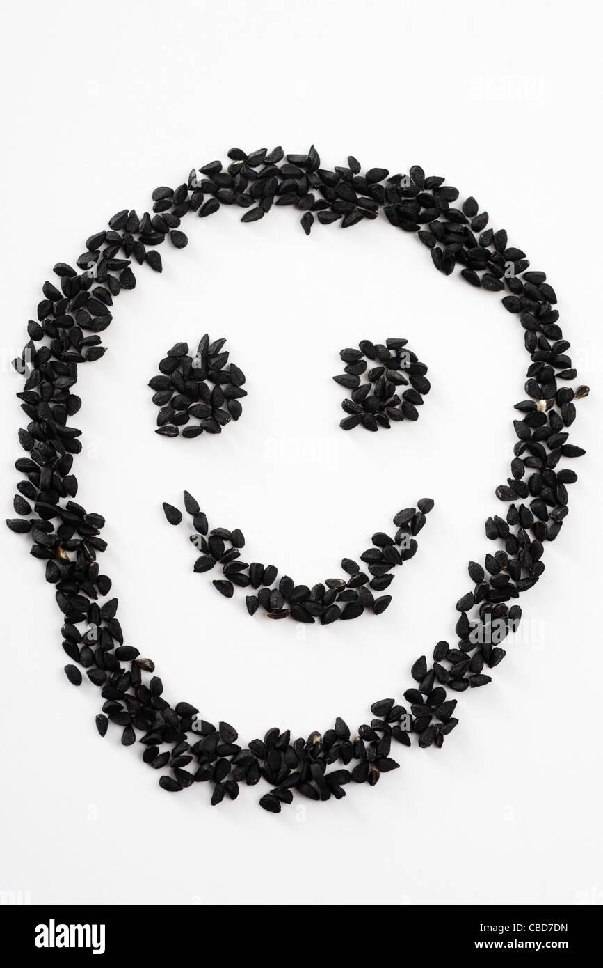 nigella seeds arranged in smiley face stock photo 41473201 alamy. Black Bedroom Furniture Sets. Home Design Ideas