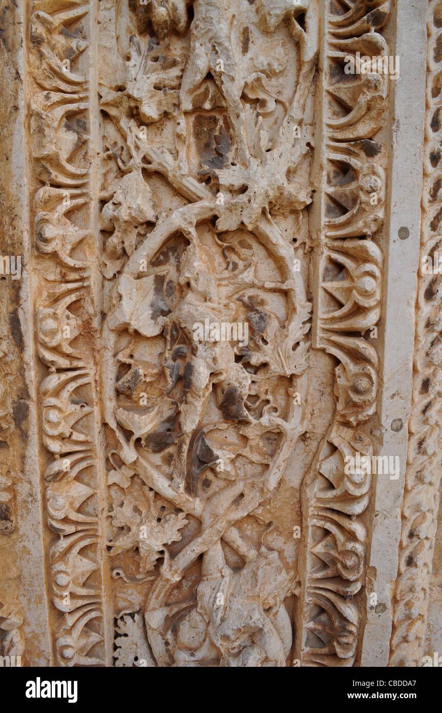 Temple of bacchus doorway stone relief work poppies