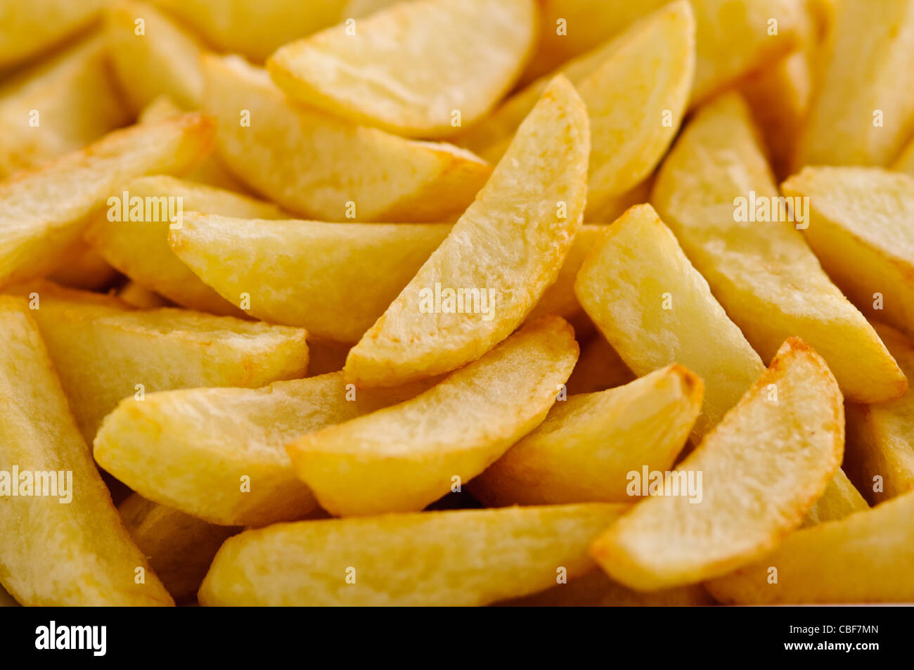 Classic British fat potato chips, cooked by deep frying in ...